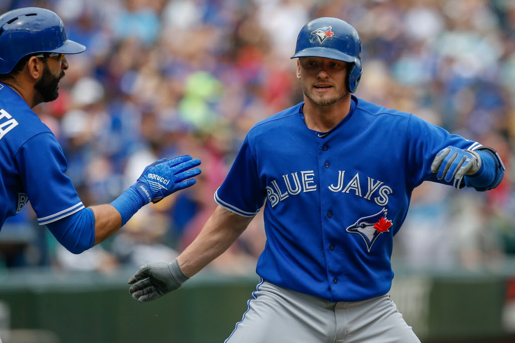 SEATTLE, WA - JULY 26:  Josh Donaldson #20 (R) of the Toronto Blue Jays is congratulated by Jose Bautista #19 after hitting a home run against the Seattle Mariners in the first inning at Safeco Field on July 26, 2015 in Seattle, Washington.  (Photo by Otto Greule Jr/Getty Images)