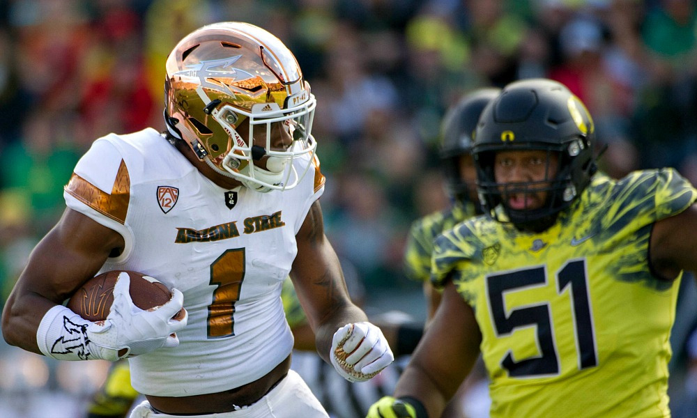 Oct 29, 2016; Eugene, OR, USA; Arizona State Sun Devils wide receiver N'Keal Harry (1) carries the ball as Oregon Ducks defensive lineman Gary Baker (51) defends during second quarter at Autzen Stadium. Mandatory Credit: Cole Elsasser-USA TODAY Sports